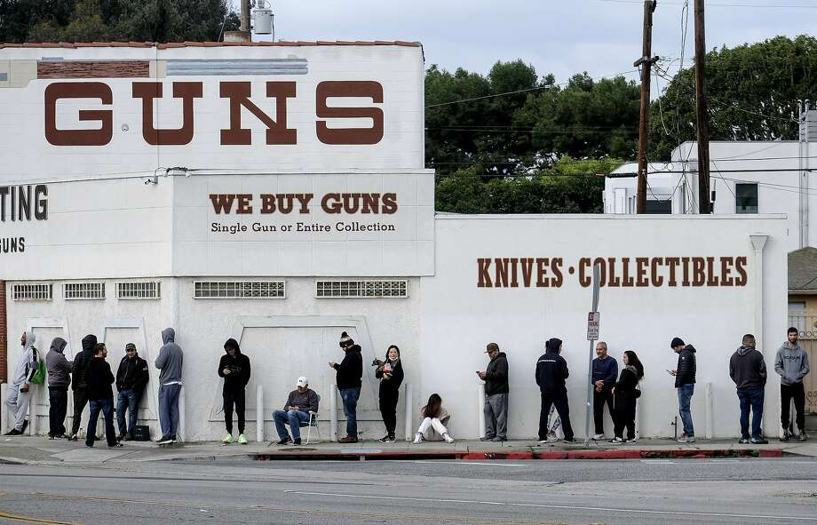 FILE - In this March 15, 2020, file photo, people wait in line to enter a gun store in Culver City, Calif. Los Angeles County Sheriff Alex Villanueva, who was sued by gun-rights groups after trying to shut down firearms dealers in the wake of coronavirus concerns, said Monday, March 30, that he is abandoning the effort. Photo: Ringo H.W. Chiu / Associated Press