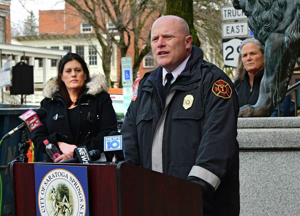 Saratoga Springs Fire Chief Joseph Dolan speak outside of Saratoga Springs City Hall on Tuesday, March 31, 2020 in Saratoga Springs, N.Y. Behind him is Commissioner of Public Safety Robin Dalton and Mayor Meg Kelly. His committee approved a higher bid for the construction of an eastside fire and EMS station. City Council unanimously approved it Tuesday. (Lori Van Buren/Times Union)