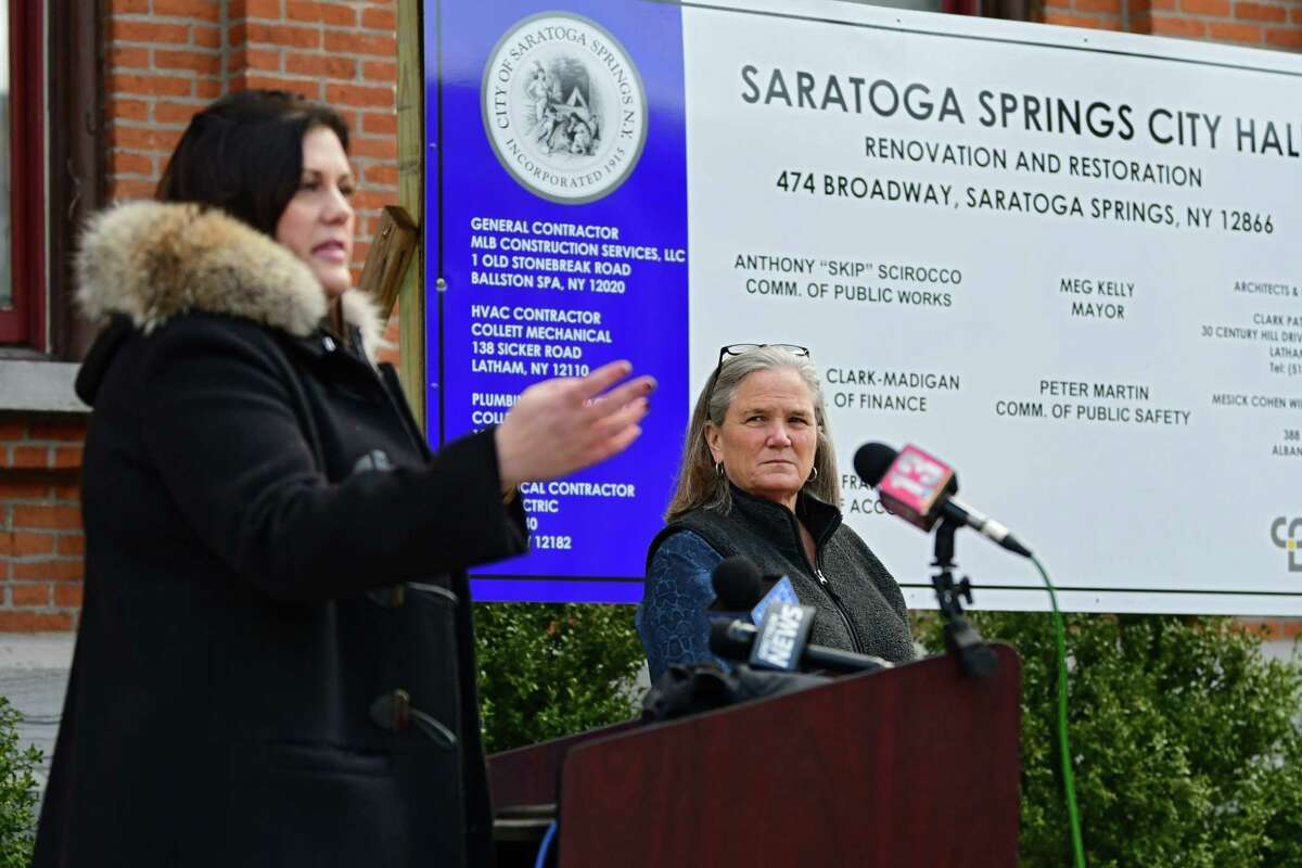 Saratoga Springs Mayor Meg Kelly, right, listens as Commissioner of Public Safety Robin Dalton speak outside Saratoga Springs City Hall on Tuesday, March 31, 2020 in Saratoga Springs, N.Y. Kelly tried to remove the public from the City Council meeting on Tuesday, July 6, 2021. (Lori Van Buren/Times Union)
