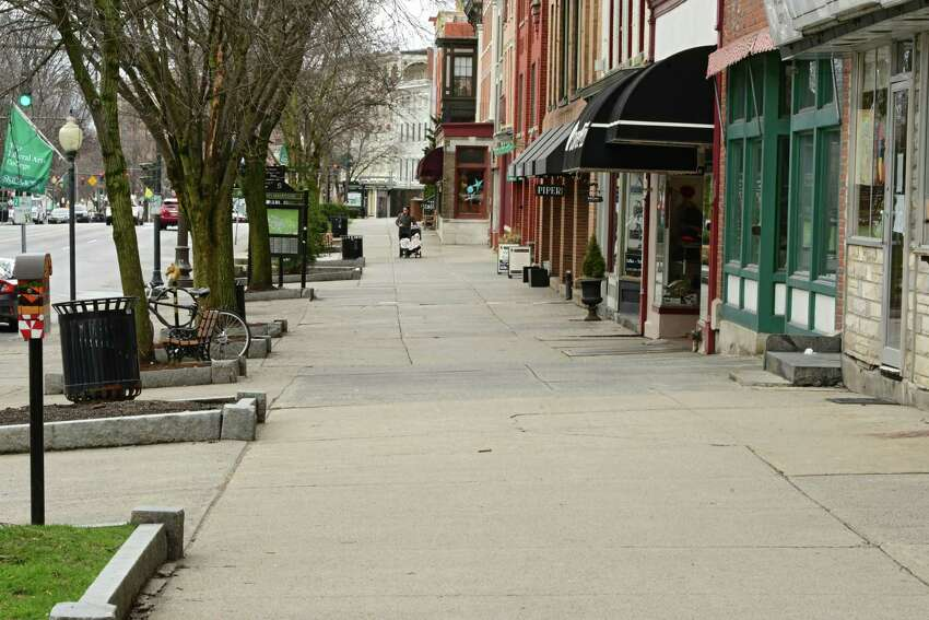Sidewalks along Broadway are practically bare on Tuesday, March 31, 2020 in Saratoga Springs, N.Y. (Lori Van Buren/Times Union)