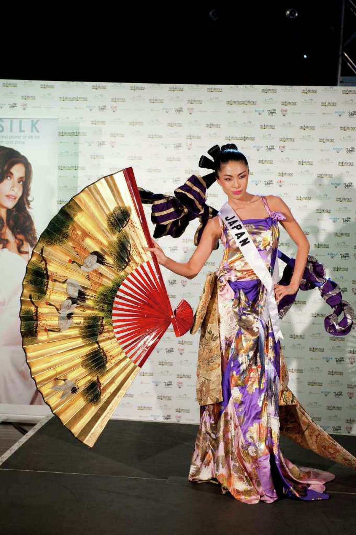 In a photo provided by the Miss Universe Organization, Maiko Itai, Miss Japan 2010, poses in her national costume at the Mandalay Bay Resort and Casino in Las Vegas Monday, August 16, 2010. (AP Photo/Matt Petit/Miss Universe Organization LP, LLLP)