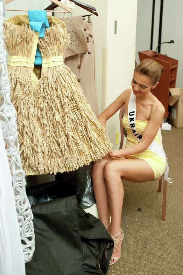 In a photo provided by the Miss Universe Organization, Anna Poslavska, Miss Ukraine 2010, prepares her costume for the Miss Universe National Costume event at Mandalay Bay Hotel and Casino in Las Vegas Monday, August 16, 2010. (AP Photo/Darren Decker/Miss Universe Organization LP, LLLP) Photo: Darren Decker / Miss Universe Organization