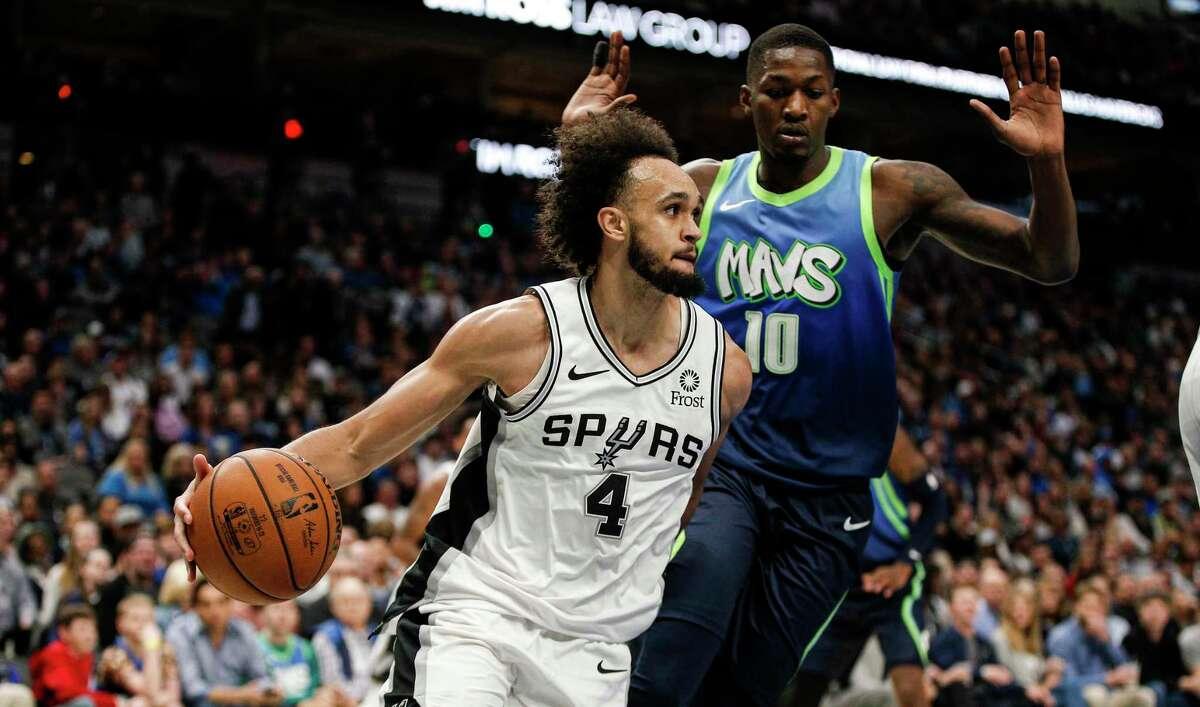 San Antonio Spurs guard Derrick White (4) looks for room against Dallas Mavericks forward Dorian Finney-Smith (10) during the second half of an NBA basketball game, Thursday, Dec. 26, 2019, in Dallas. Dallas won 102-98. (AP Photo/Brandon Wade)