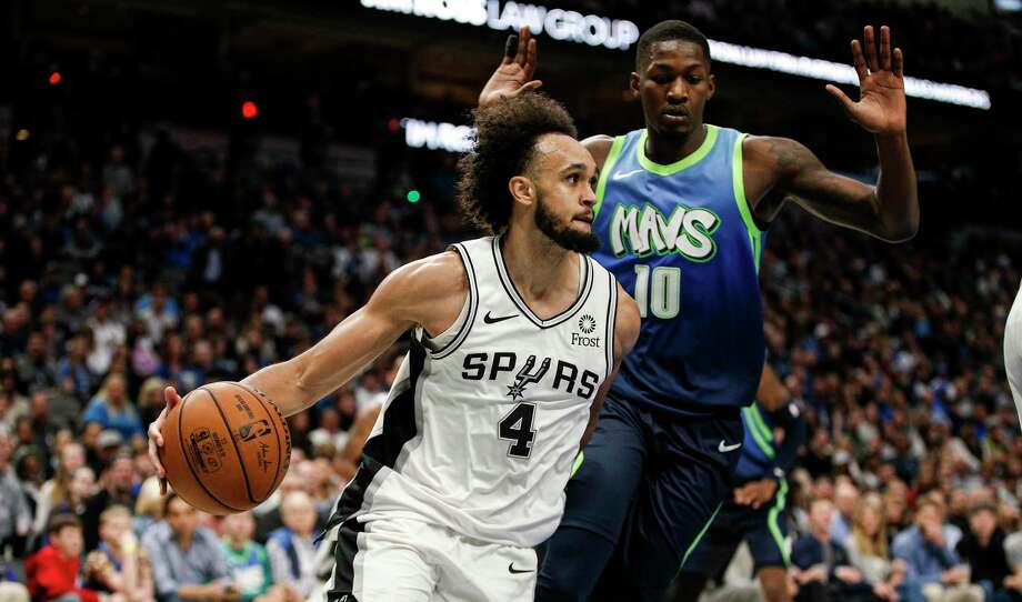 San Antonio Spurs guard Derrick White (4) looks for room against Dallas Mavericks forward Dorian Finney-Smith (10) during the second half of an NBA basketball game, Thursday, Dec. 26, 2019, in Dallas. Dallas won 102-98. (AP Photo/Brandon Wade) Photo: Brandon Wade, FRE / Associated Press / Copyright 2019 The Associated Press. All rights reserved.