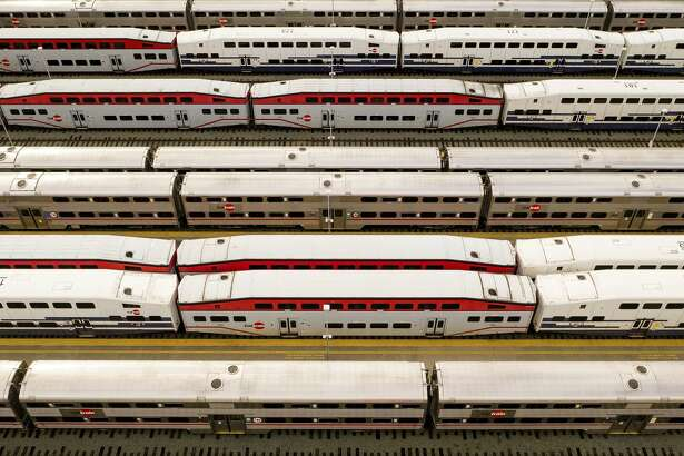 During the peak of commute hours, Caltrain cars sit dormant at San Francisco's 4th & King Street station on Monday, March 30, 2020. On Monday, the agency indefinitely cut weekday service to 42 trains instead of the normal 92 as coronavirus shelter-in-place orders remain in effect.