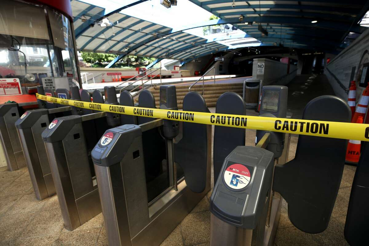 In this file photo, gates at the San Francisco MUNI Metro West Portal station are blocked with caution tape. After reopening 3 days ago, SF Muni has once again shut down light rail service after some overhead wire issues and an employee testing positive at the system's control center.
