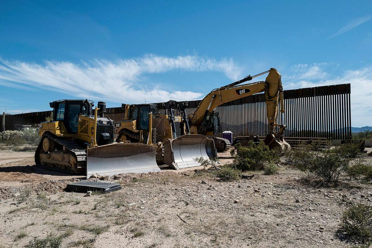 Construction equipment for the border wall in Organ Pipe Cactus National Monument, near Ajo, Ariz., March 25, 2020. Some disease specialists in Arizona are warning that workers clustered in tight quarters along the border could spread the coronavirus around the country when they return to their families. (Adriana Zehbrauskas/The New York Times)