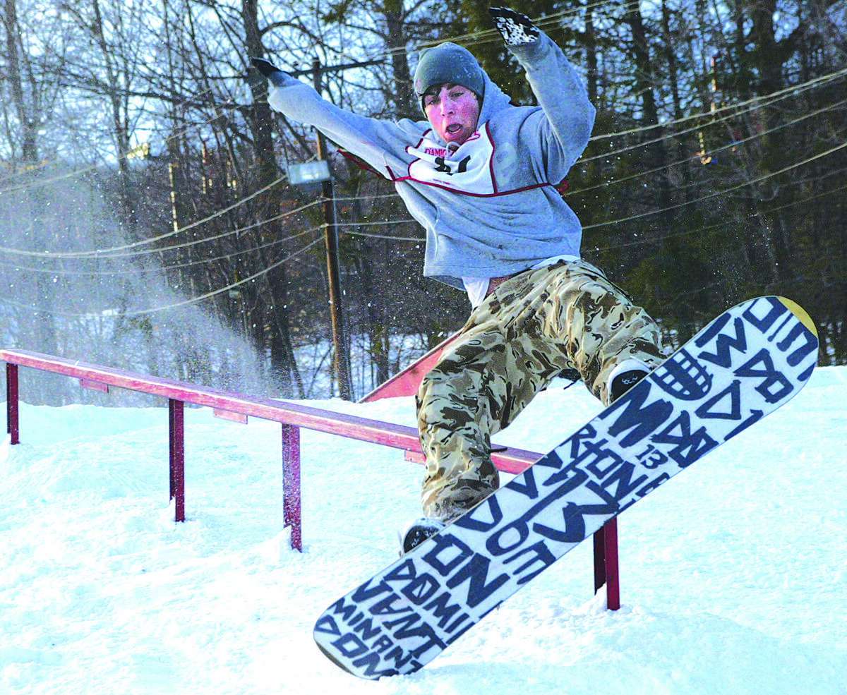 Eric Hetsco, age 14, of Killingworth, tries to land after completing a rail trick at Powder Ridge in Middlefield. The Rail Jam Competition held Sunday afternoon is part of a continuing competition with the winner getting a trip to Canada......photo by Sarah Schultz......1.30.05