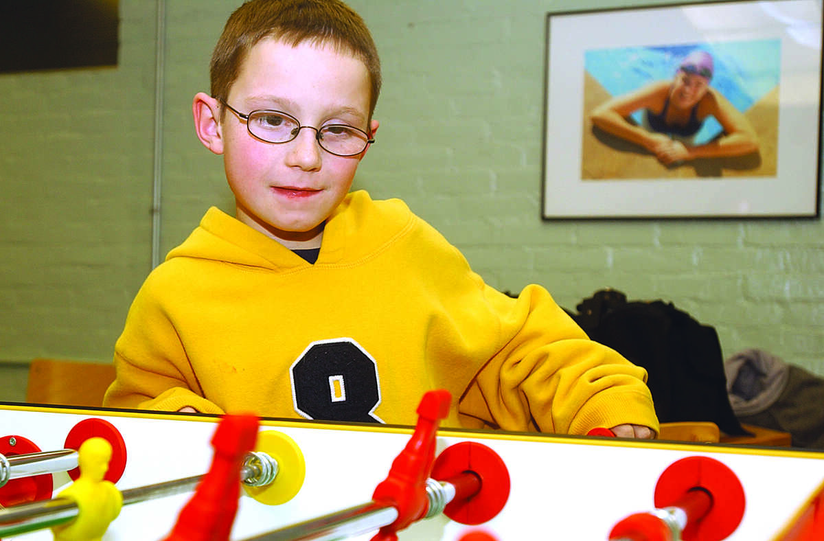 Noah LaPointe, age 8, of Portland concentrates on his next move during his foosball game as part of the snow day program offered at the YMCA in Middletown........photo by Sarah Schultz.....1.6.05