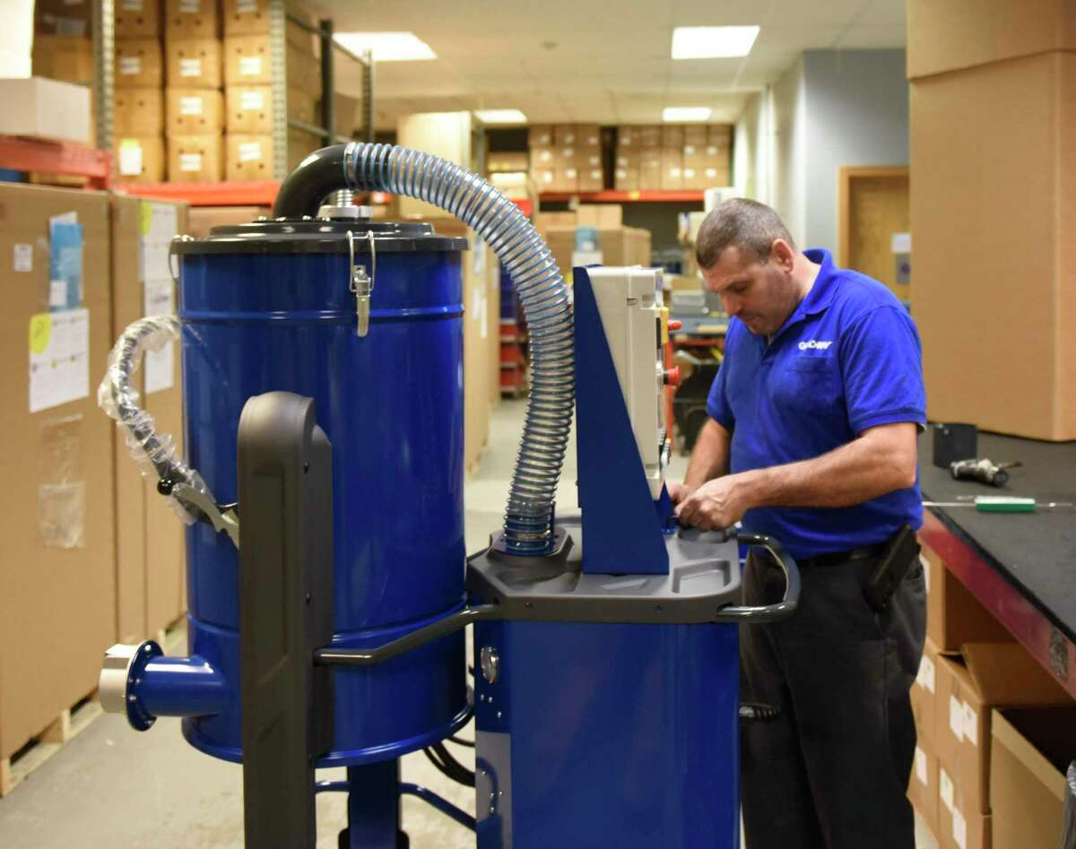 Employees work at the Goodway Technologies manufacturing plant in Stamford, Conn. Monday, March 30, 2020. Goodway is an essential service with its production facility still open to produce tube cleaners, industrial vacuums, descalers, steam cleaners, and more.