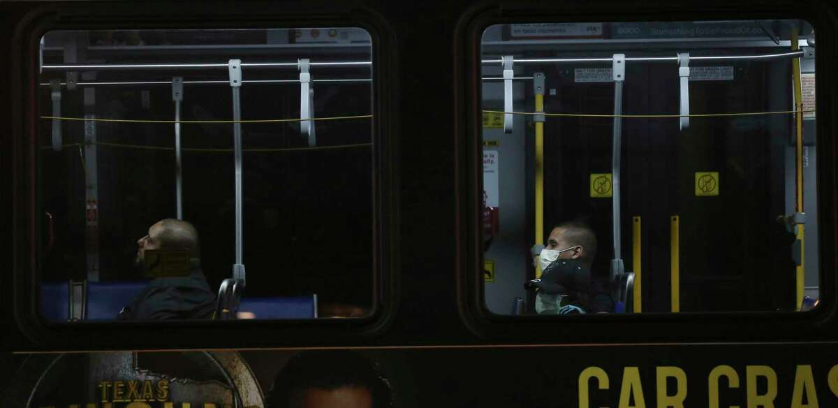 Bus riders in downtown San Antonio last month attempt to shield themselves with masks. As the coronavirus spreads, social isolation and potential substance use can deepen.