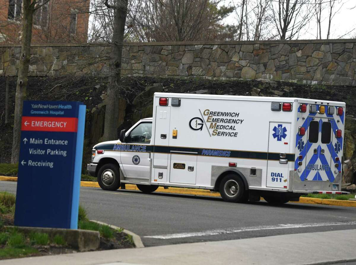 A sign directs patients to the coronavirus specimen collection siet at Greenwich Hospital in Greenwich, Conn. Tuesday, March 31, 2020.
