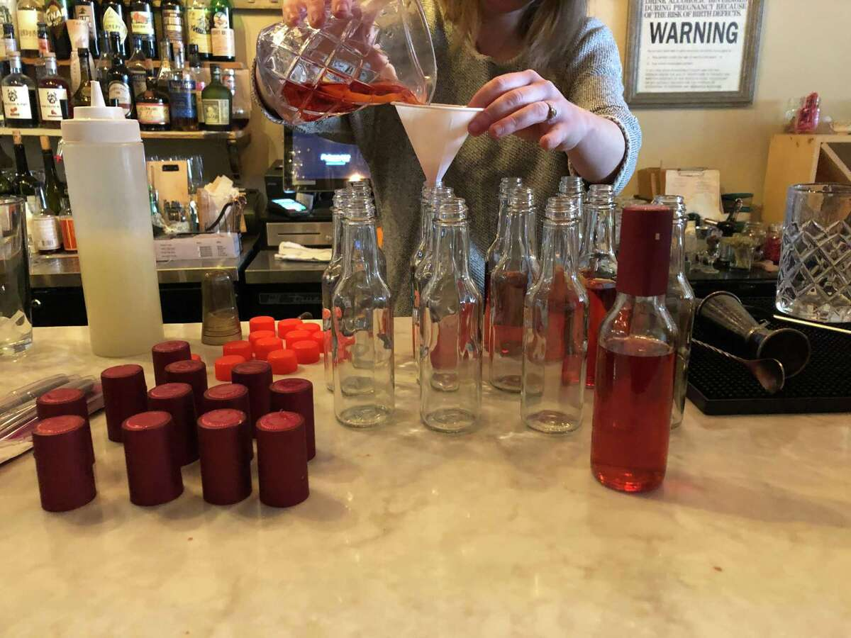 Kelly McNamee makes drinks for Plumb Oyster Bar's Cocktail Club. The Troy restaurant is planning on bringing back the Cocktail Club for the winter season.