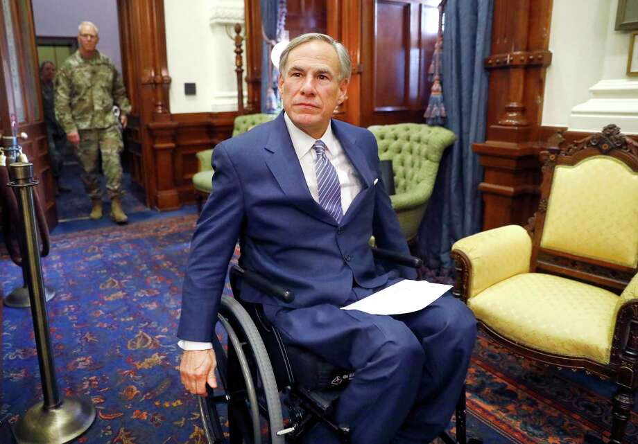 Texas Gov. Greg Abbott arrives for his COVID-19 press conference at the Texas State Capitol in Austin. He and Attorney General Ken Paxton have taken aim at abortion procedures during the coronavirus crisis. Photo: Tom Fox, MBR / TNS / Dallas Morning News