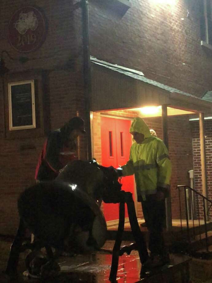 Members of Water Witch Hose Co. #2 in New Milford are ringing the historic bell in front of the firehouse every night at 8 p.m. in a show of unity, according to Fire Chief Rich Squires. The bell ringing will continue each night until the directive to stay at home is lifted. Above, Rich Squires last Saturday night. Photo: Deborah Rose / Hearst Connecticut Media
