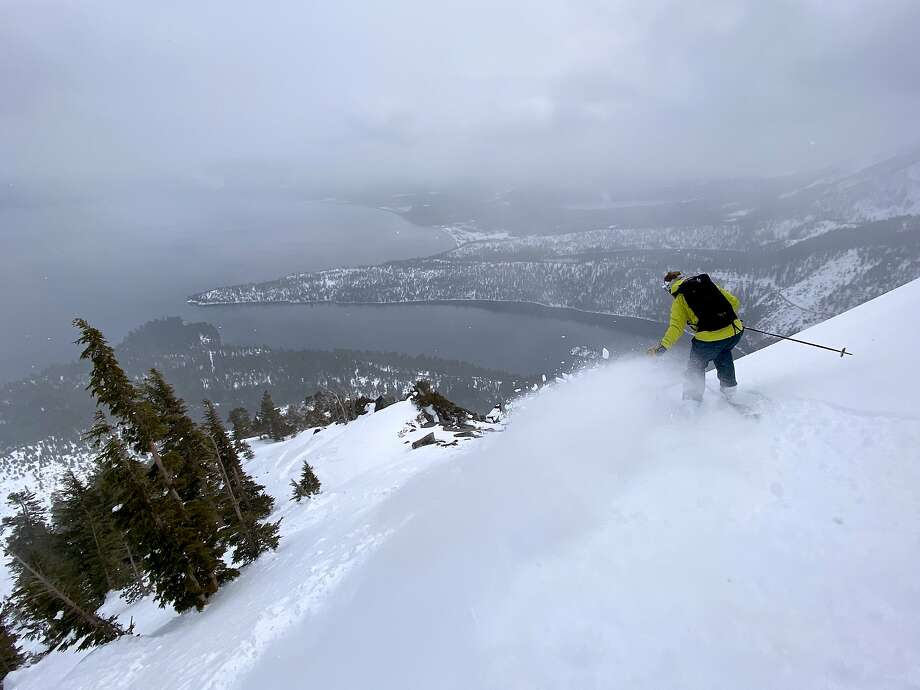 Doug Stoup trekked through snow to a wilderness ridge above Emerald Bay at Lake Tahoe, and then sailed back down -- scratching the outdoor itch without putting himself, or others, at risk amid fears of coronavirus Photo: Adam Pisoni / Adam Pisoni / Special To The Chronicle