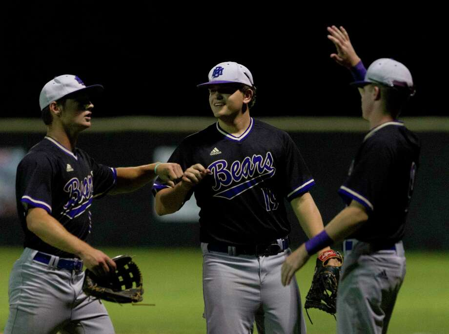 Montgomery starting pitcher Dillon Smith (10) gets a high-five from first baseman Cole Morris (19) and Grant Brown after the fifth inning of a District 20-5A high school baseball game at Caney Creek High School, Tuesday, April 23, 2019, in Grangerland. Photo: Jason Fochtman, Houston Chronicle / Staff Photographer / © 2019 Houston Chronicle
