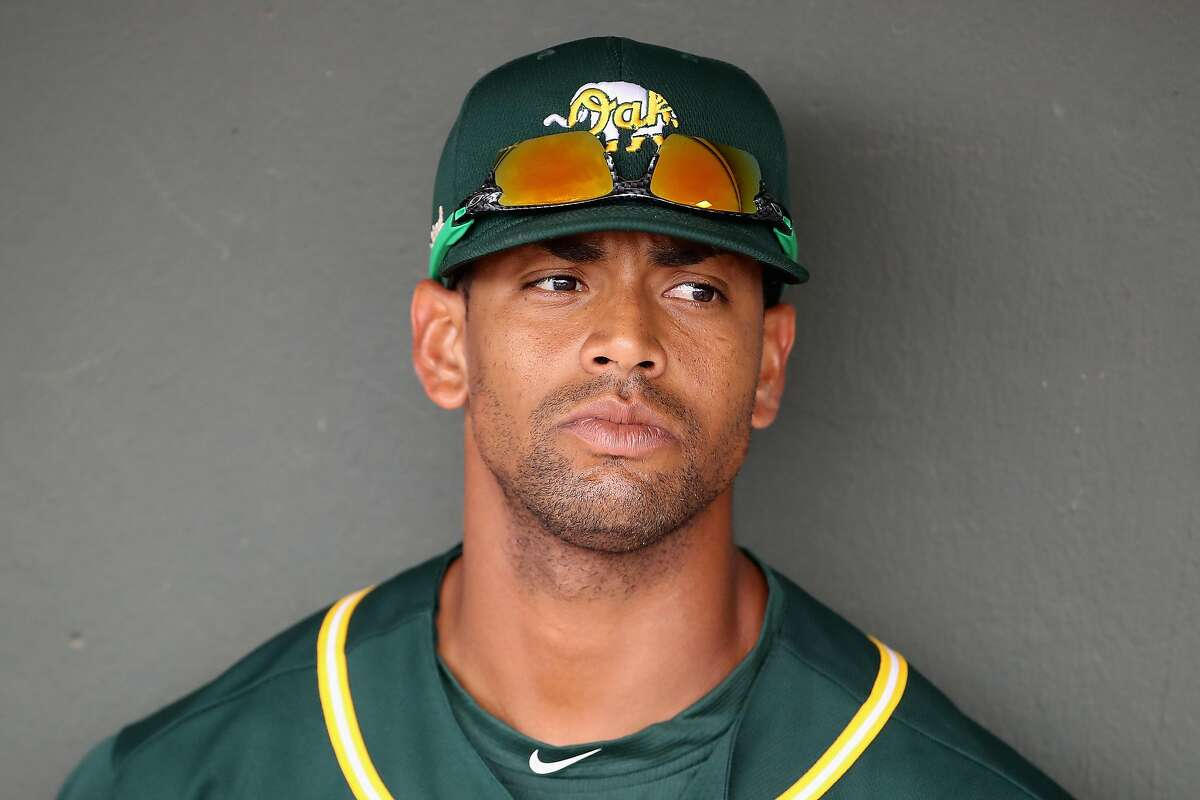 MESA, ARIZONA - MARCH 10: Khris Davis #2 of the Oakland Athletics sits in the dugout before the MLB spring training game against the Kansas City Royals at HoHoKam Stadium on March 10, 2020 in Mesa, Arizona. (Photo by Christian Petersen/Getty Images)