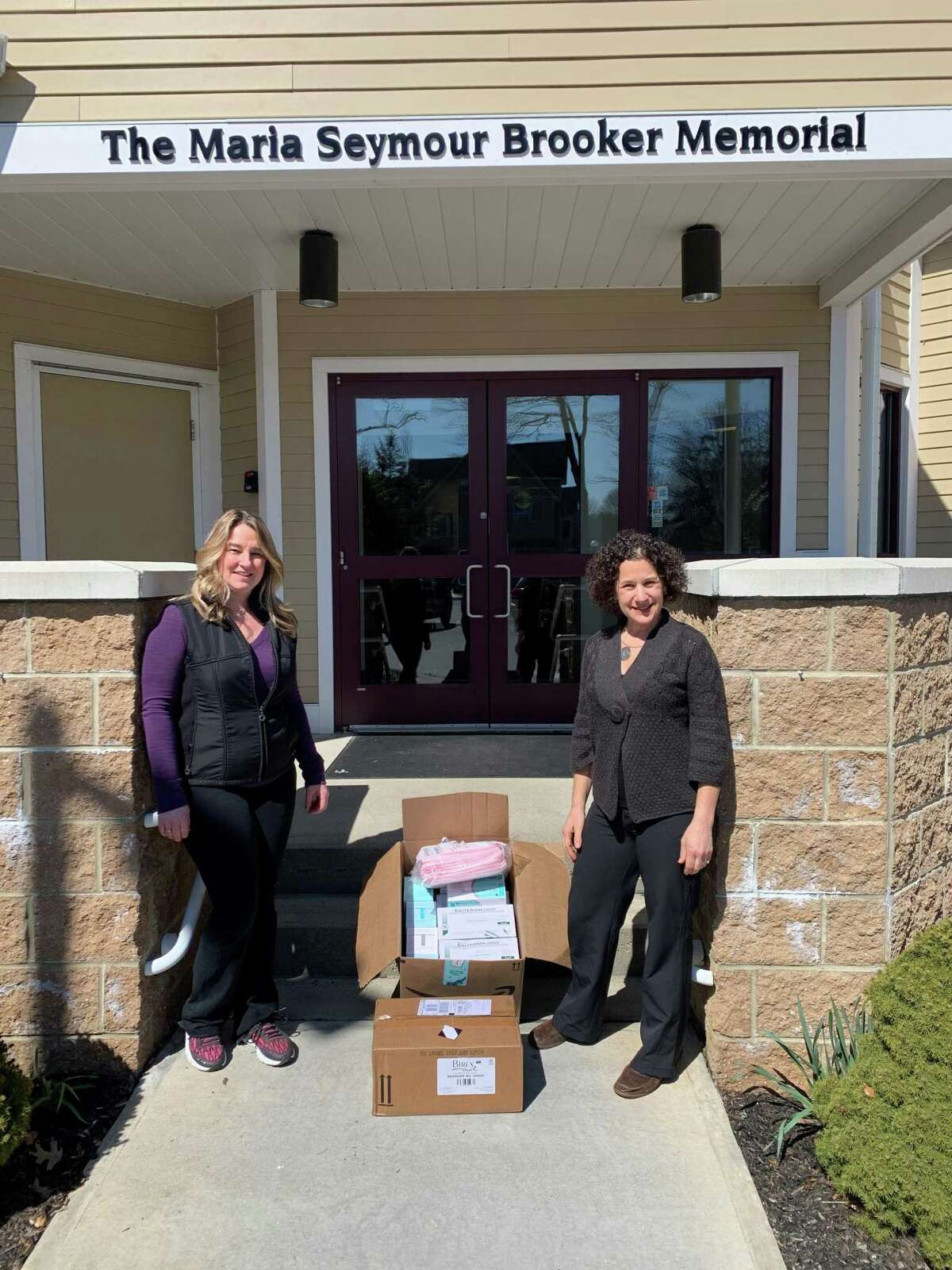 Brooker Memorial donated supplies to Charlotte Hungerford Hospital. Lisa Ferris, program manager, and Cathy Coyle, executive director, show boxes of supplies to be donated.