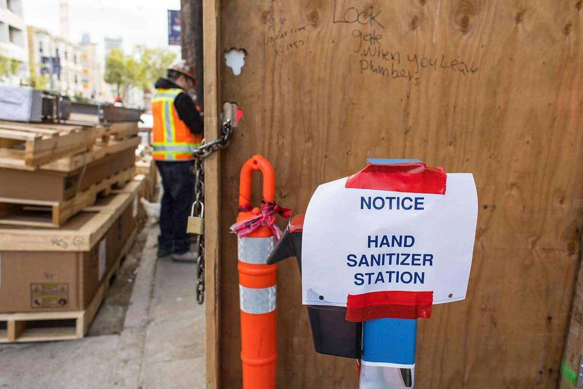 Hand sanitizer stations are placed throughout a new housing project at 950 Gough Street on Tuesday, March 31, 2020 in San Francisco, Calif.