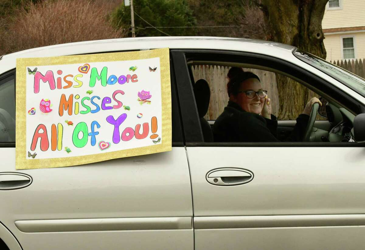 Delmarie Moore drives her car with a message as teachers and staff from Gardner-Dickinson School ride in a Royal Parade on Tuesday, March 31, 2020 in Troy, N.Y. The staff were waving to families who have to stay at home because of the Coronavirus pandemic. (Lori Van Buren/Times Union)