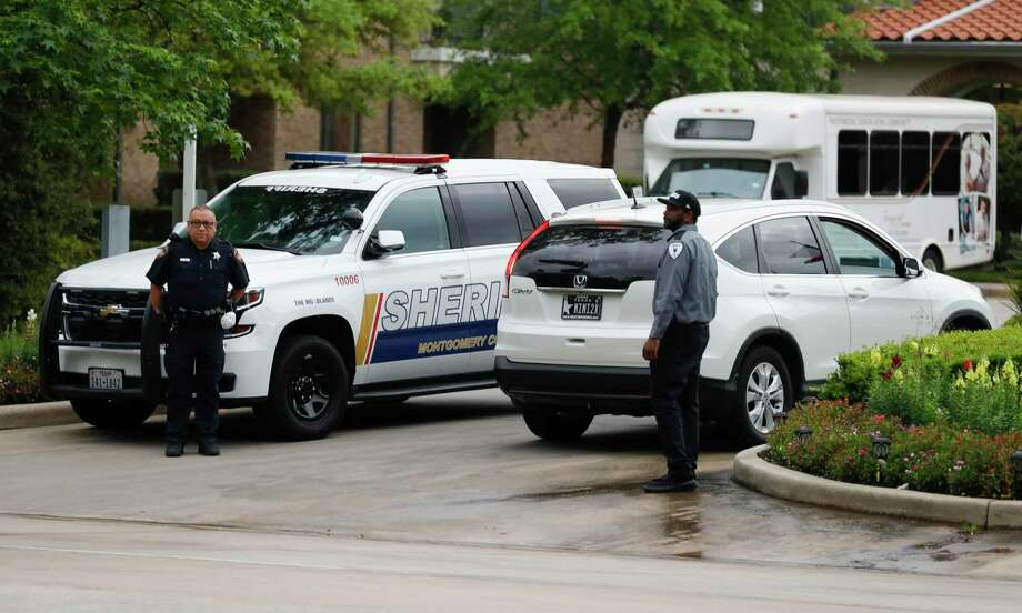 Officers with Montgomery County Sheriff's Office provide added security and screening at The Conservatory at Alden Bridge after 12 residents tested positive for coronavirus, Tuesday, March 31, 2020, in The Woodlands. On Monday, Montgomery County Judge Mark Keough issued a shelter-in-place order for residents of the senior living community that offers apartment homes for up to 237 residents. Photo: Jason Fochtman, Houston Chronicle / Staff Photographer / 2020 © Houston Chronicle