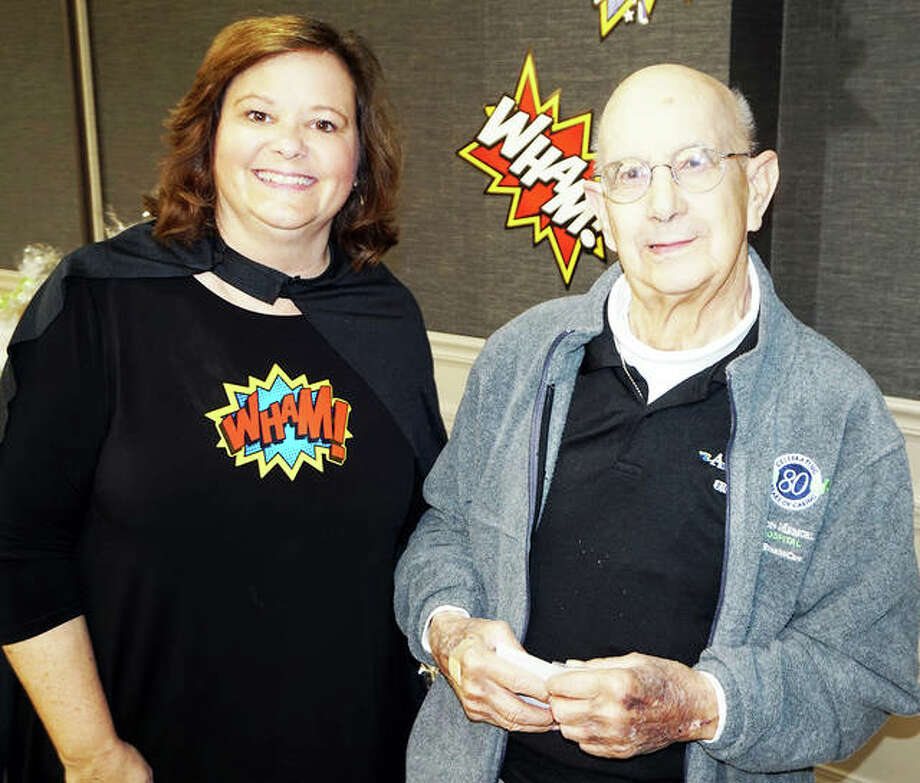 Carl received a pin for 40,000 volunteer hours from AMH Volunteer Coordinator Kathleen Turner at last year's volunteer luncheon. Photo: For The Telegraph
