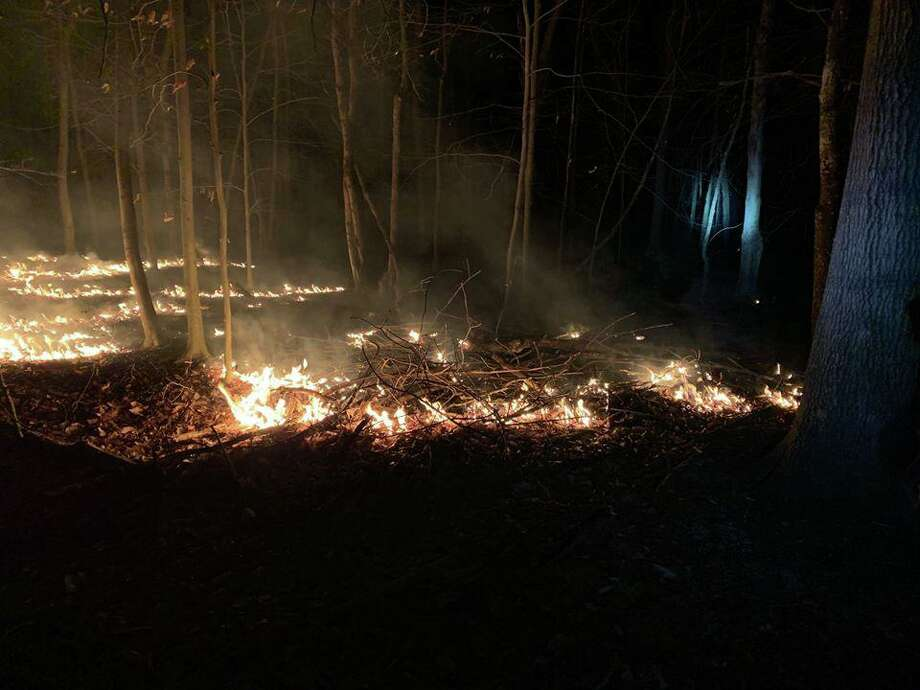 At 9:30 p.m. Friday, March 27, firefighters were dispatched to a reported brush fire in the wooded area between Tubbs Springs Road and Lords Highway/Stone Cliff Lane. Photo: Contributed Photo / Weston Volunteer Fire Department