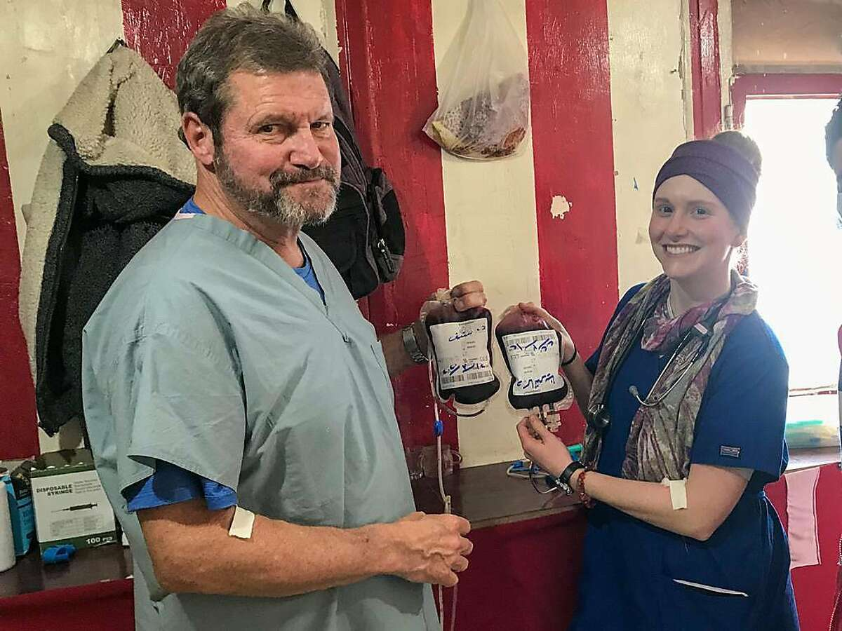 Dr. Steve Whiteley, a Bay Area resident and retired ER doctor, pictured with colleague Katie Biniki after donating blood while volunteering overseas. The two are stranded in Iraq and are not sure when they'll return home to help treat COVID-19 patients.