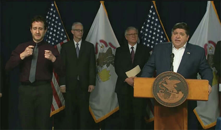 Gov. JB Pritzker announces that the stay-at-home order in Illinois is being extended through April in Illinois during a news conference Tuesday in Chicago. All residents are now asked to remain at home except for essential business through April 30 to help slow the outbreak of COVID-19 in Illinois. Photo: Credit: Blueroomstream.com