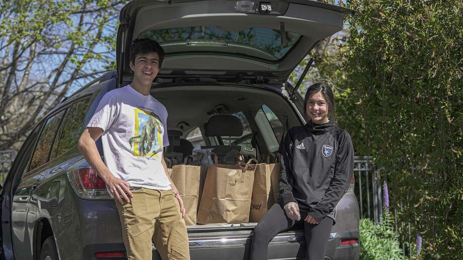Los Altos seniors Greg Corn and Kayleen Gowers are delivering groceries to neighbors in need, for free, during the Bay Area shelter in place order. Photo: Courtesy San Jose Earthquakes