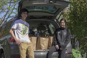 Los Altos seniors Greg Corn and Kayleen Gowers are delivering groceries to neighbors in need, for free, during the Bay Area shelter in place order.