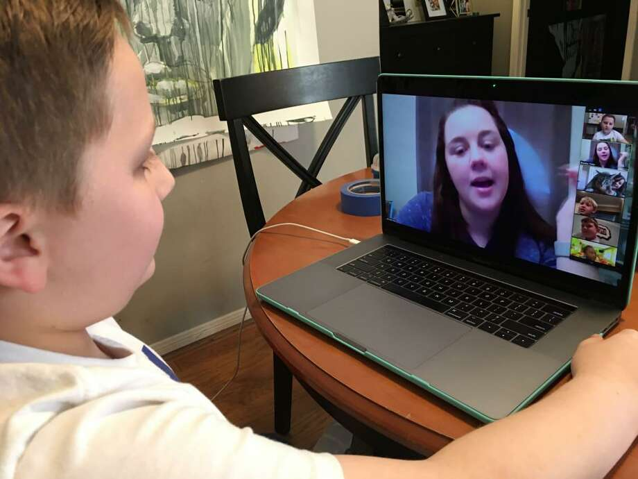 BrookeTolar, a second-grade teacher atMemorial Drive Elementary, interacts with her students via video these days. Photo: Courtesy Photo