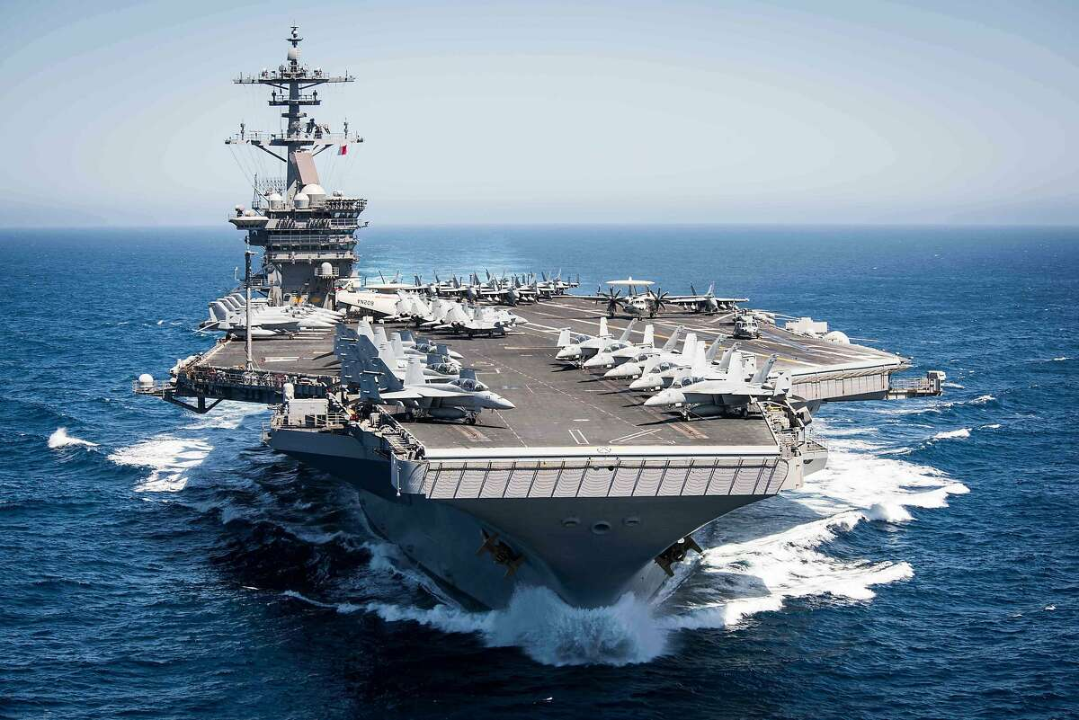 """(FILES) This US Navy file handout photo shows the aircraft carrier USS Theodore Roosevelt (CVN 71)as it transits the Pacific Ocean while conducting a tailored ships training availability off the coast of Southern California on April 30, 2017. - The captain of the nuclear aircraft carrier with more than 100 sailors infected with the coronavirus pleaded on March 30, 2020 with US Navy officials for resources to allow isolation of his entire crew, and avoid possible deaths in a situation he described as quickly deteriorating. (Photo by Paul L. ARCHER / US NAVY / AFP) / RESTRICTED TO EDITORIAL USE - MANDATORY CREDIT """"AFP PHOTO / US NAVY/MCS 2NDC PAUL L. ARCHER"""" - NO MARKETING NO ADVERTISING CAMPAIGNS - DISTRIBUTED AS A SERVICE TO CLIENTS (Photo by PAUL L. ARCHER/US NAVY/AFP via Getty Images)"""