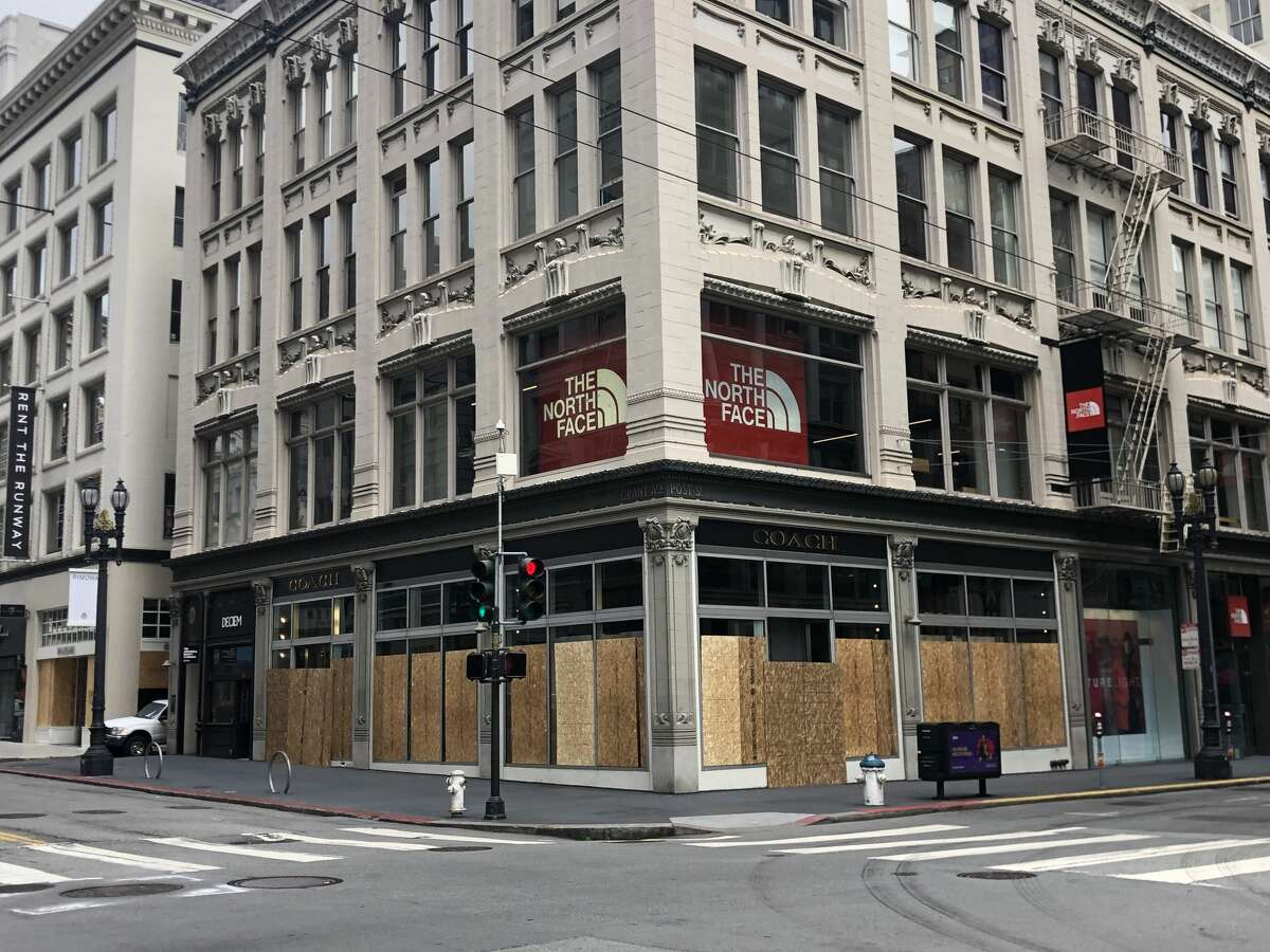 The Coach store, boarded up during the coronavirus shutdown in San Francisco.