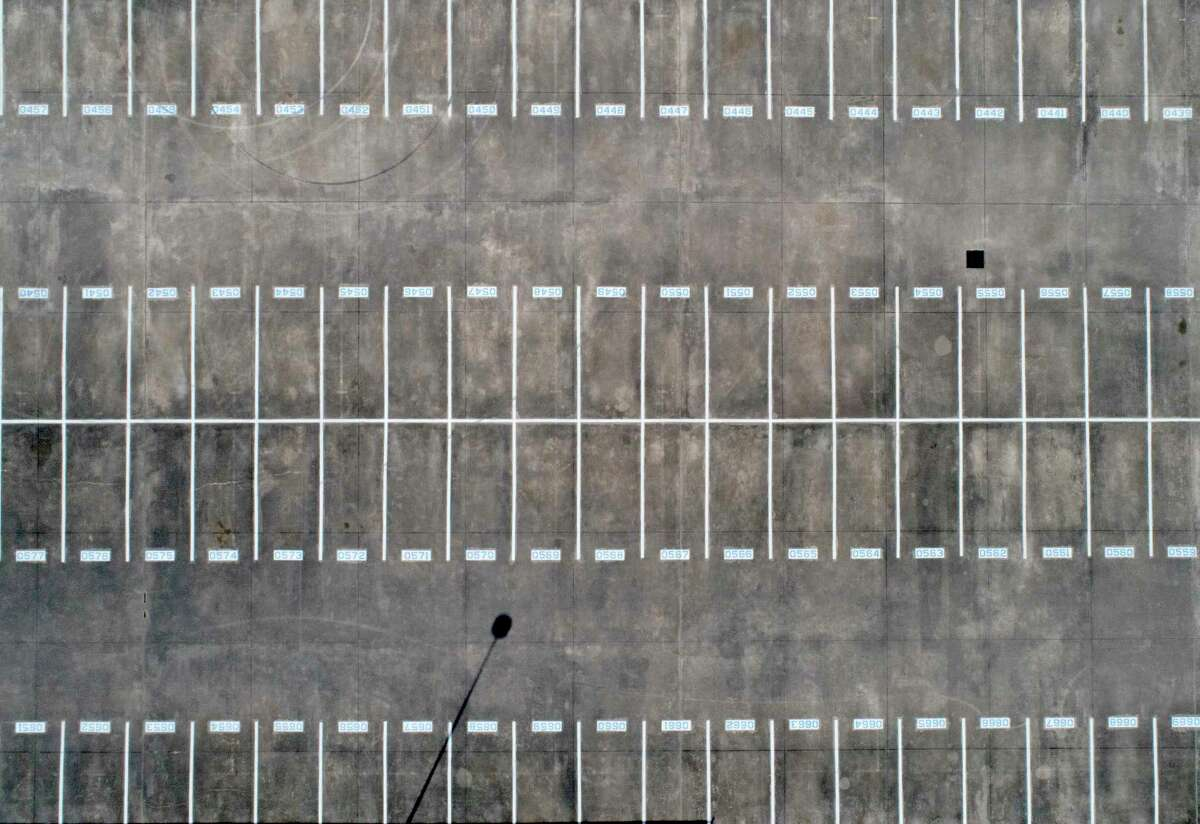 An aerial image of the student parking lot at College Park High School is seen, Friday, March 27, 2020, in The Woodlands.
