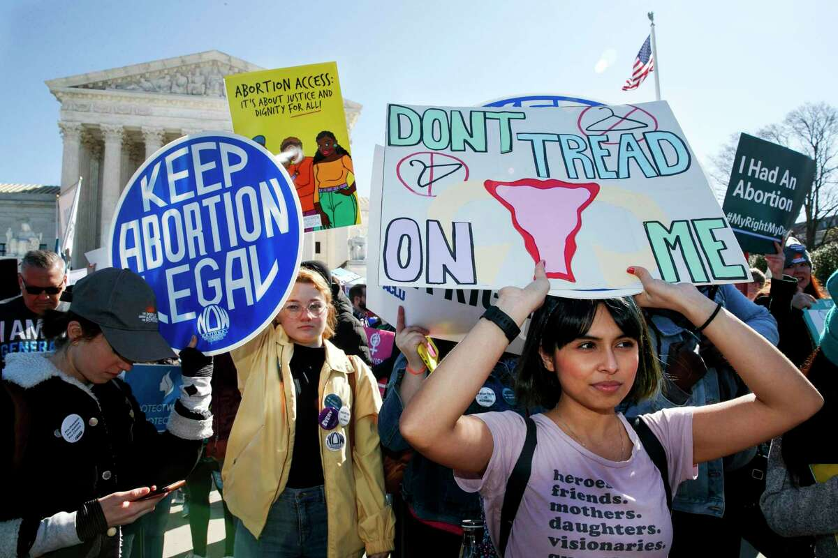 Abortion rights demonstrators including Jaylene Solache, of Dallas, Texas, right, rally, Wednesday, March 4, 2020, outside the Supreme Court in Washington. (AP Photo/Jacquelyn Martin)