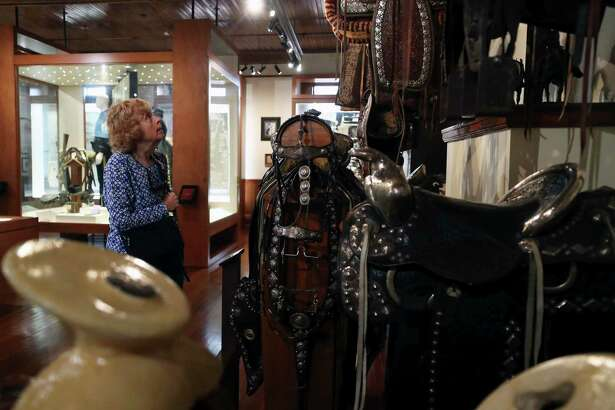 Ann Ryan looks at old saddles displayed at the Bryan Museum in Galveston. The Bryan Museum in Galveston is home to one of the world's largest collections of art and artifacts relating to the history of the Southwest. The entire museum can now be toured virtually, and there are resource pages to supplement the visits: www.thebryanmuseum.org. Along with their truly Texas virtual experience, The Bryan Museum is also providing daily lesson plans for at-home learning called the Historians Journal.