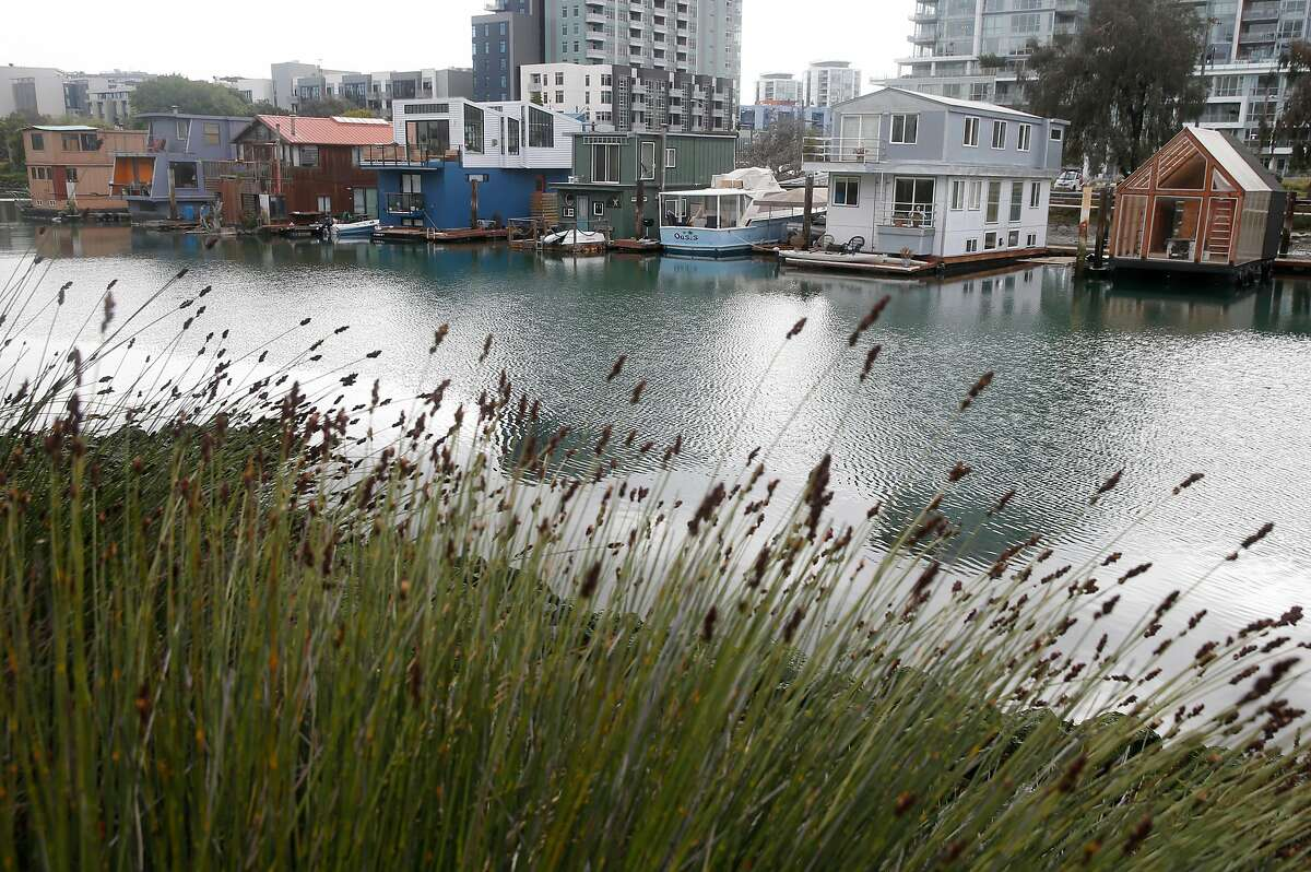 Houseboats line the southern shore of Mission Creek in San Francisco, Calif. on Tuesday, March 31, 2020. A new study suggests that sea level rise could adversely affect Mission Creek's ecosystem and nearby infrastructure projects like the water pumping station and Caltrain tracks running along 7th Street.