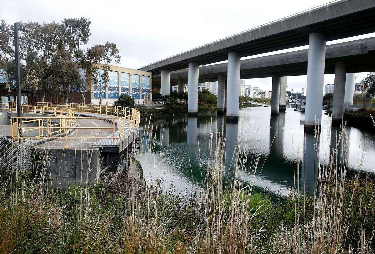 A pump station (left) operates at the foot of Mission Creek in San Francisco, Calif. on Tuesday, March 31, 2020. A new study suggests that sea level rise could adversely affect Mission Creek's ecosystem and nearby infrastructure projects like the water pumping station and Caltrain tracks running along 7th Street.