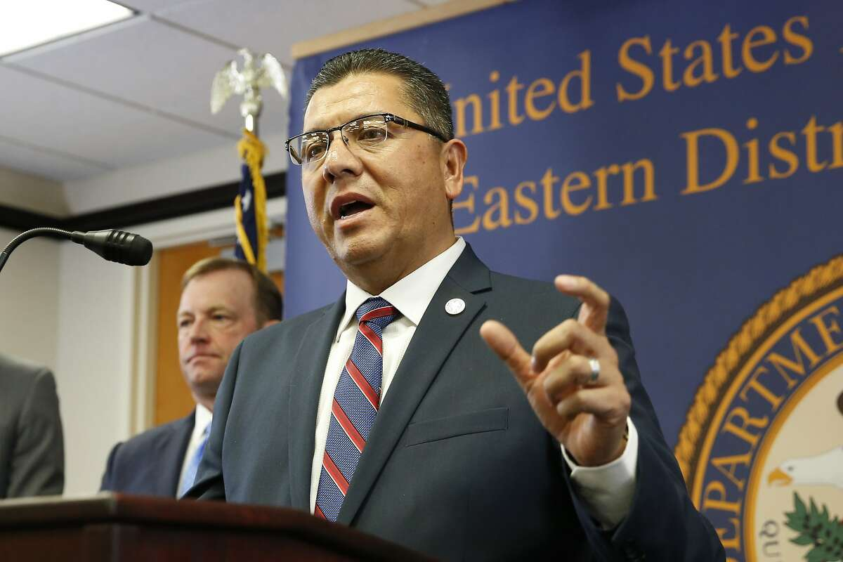 Ralph Diaz, the Secretary of the California Department of Corrections and Rehabilitation, answers questions concerning the charges against leaders of the white supremacist prison gang, the Aryan Brotherhood, during a news conference in Sacramento, Thursday, June 6, 2019. Aryan Brotherhood members and associates are accused of running a criminal enterprise using contraband cellphones, encrypted chats, text messages, multimedia messages and email.The charges detail five slayings and accuse an attorney of helping smuggle drugs and cellphones to aid the white supremacist gang. At left is McGregor Scott, the United States Attorney for the Eastern District of California. (AP Photo/Rich Pedroncelli)