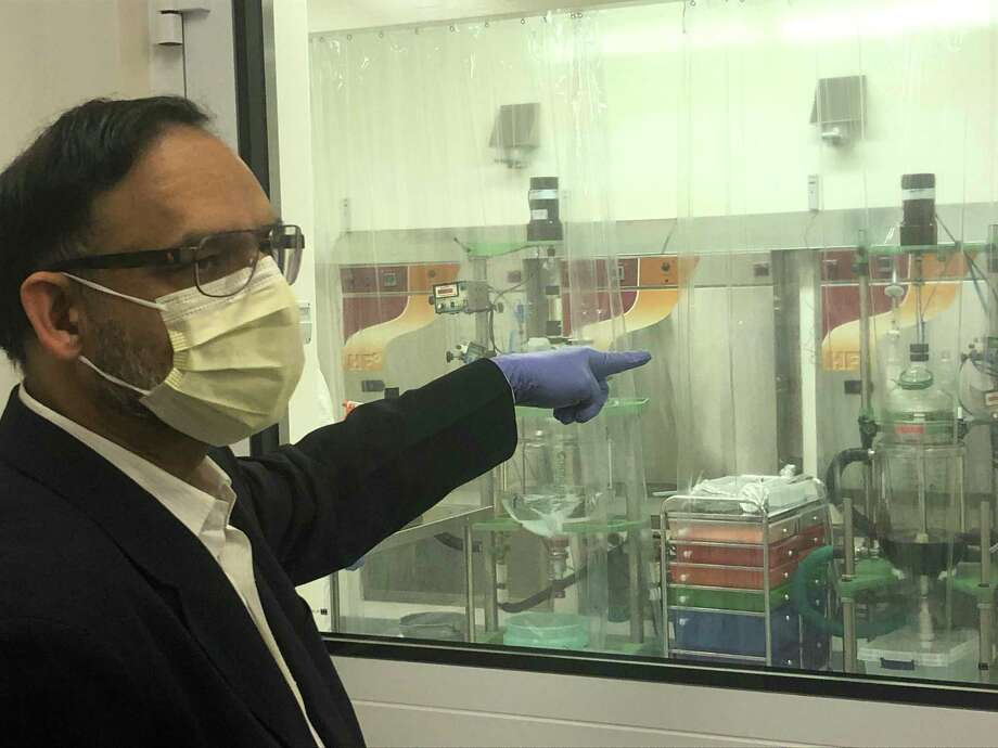 Anil R. Diwan, president and chairman of NanoViricides Inc. in Shelton, Conn., eplains how his company is working on developing a potential treatment for COVID-19 on Tuesday. Photo: Kaitlyn Krasselt /