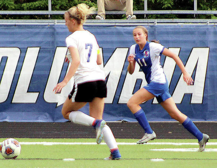 Macie Lucas of Roxana, right, gives chase against Columbia's Taylor Parks during the 2018 Columbia Class1A Sectional Tournament. Lucas scored 16 goals and had 18 assists. A junior this season, Lucas is one of the standouts heading into the season, which is now in doubt because of the shutdown of spring sports because of the coronavirus. Photo: Pete Hayes | The Telegraph