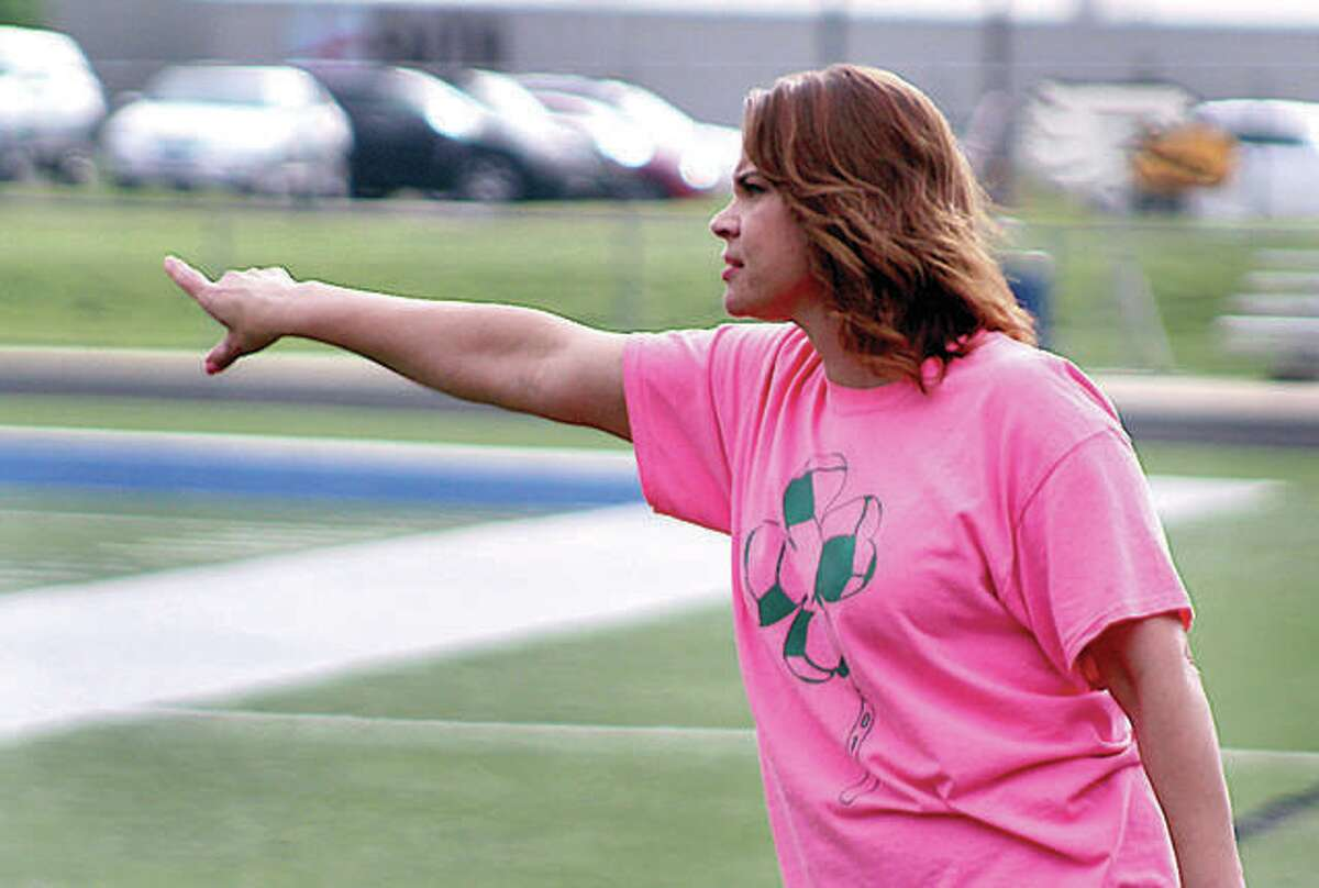 Roxana coach Lori Yates directs her team last season. She and other spring sports coaches are awaiting word on when or if sports will resume.