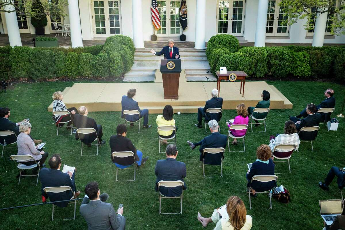 President Donald Trump speaks with members of the coronavirus task force and reporters at the White House on Monday, March 30, 2020.