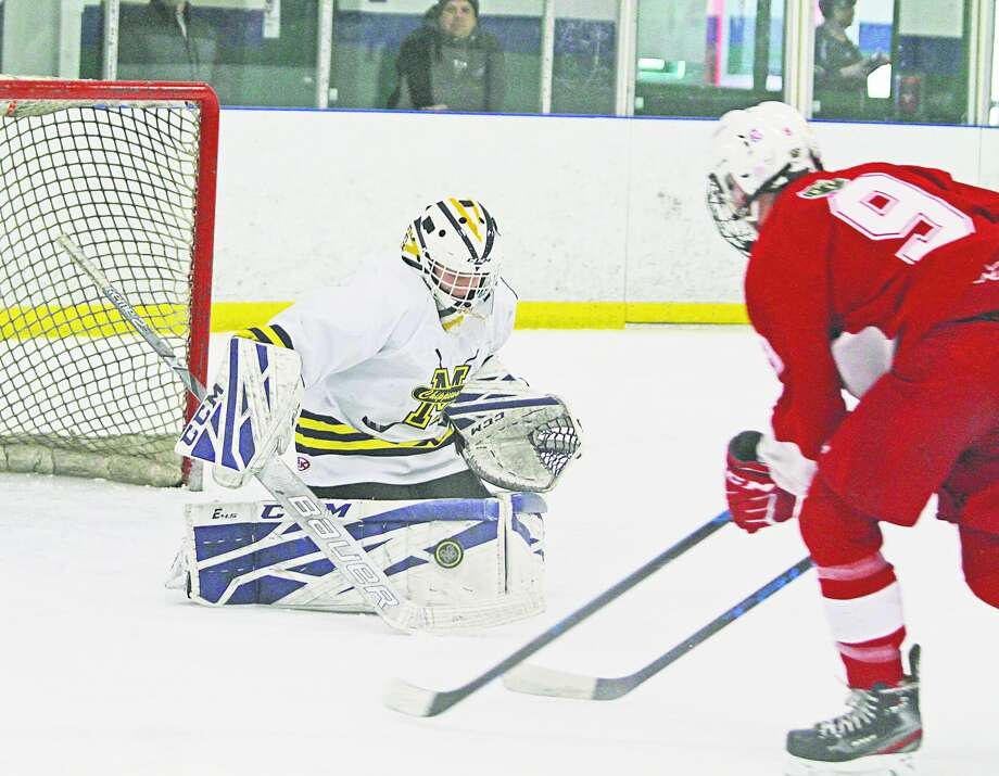 Manistee goaltender Alex Shriver makes a save. Shriver received honorable mention all-conference honors this season in the Northern Michigan Hockey League. Photo: News Advocate File Photo