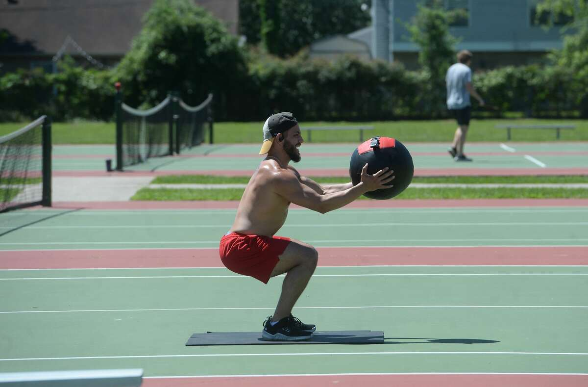 Chris Gutierrez works out on the courts at Rogers Park as he joins area residents in some outdoor recreation and sun in Rogers Park Tuesday. Photo taken Tuesday, March 31, 2020 Kim Brent/The Enterprise