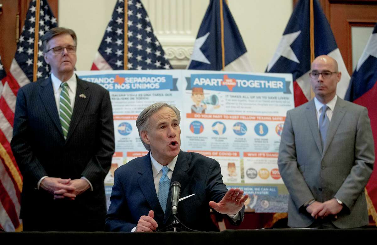 Texas Gov. Greg Abbott, flanked by Lt. Gov. Dan Patrick, left, and House Speaker Dennis Bonnen, speaks during a press conference at the state Capitol about the state's response to the coronavirus on Tuesday, March 31, 2020, in Austin, Texas.