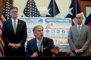 Texas Gov. Greg Abbott, center, used his authority Tuesday to order the closure of the state's public and private schools.
