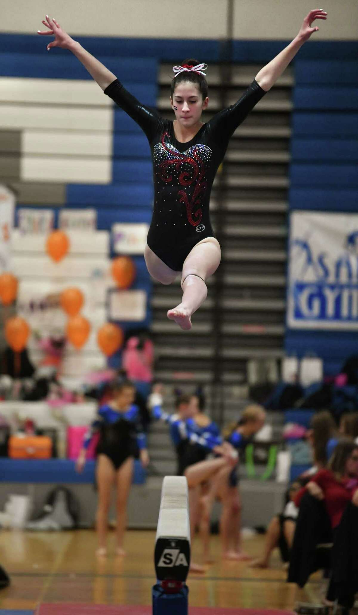 Guilderland's Addison Seebode competes on the balance beam during the Section II Gymnastics sectionals at Shaker High School on Wednesday, Feb. 12, 2020 in Latham, N.Y. (Lori Van Buren/Times Union)